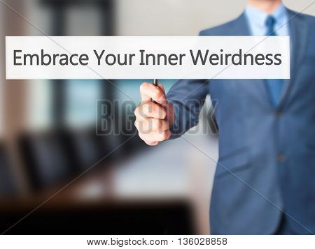 Embrace Your Inner Weirdness - Businessman Hand Holding Sign