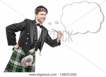 Scottish Man In Traditional Costume With Smoking Pipe And Empty Banner