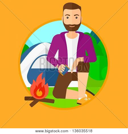 A hipster man with the beard kindling a campfire on the background of camping site with tent. Tourist relaxing near campfire. Vector flat design illustration in the circle isolated on background.