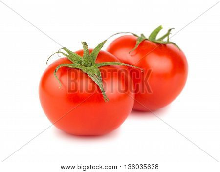 Two red ripe tomato on white background