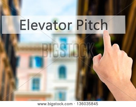 Elevator Pitch - Hand Pressing A Button On Blurred Background Concept On Visual Screen.
