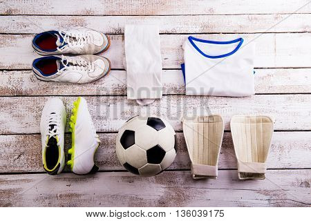 Soccer Ball,cleats And Various Football Stuff, Wooden Background