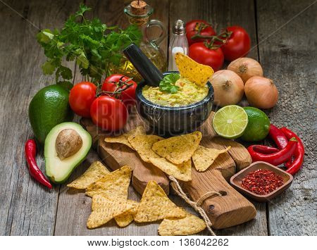 Bowl Of Delicious Homemade Guacamole With Nachos