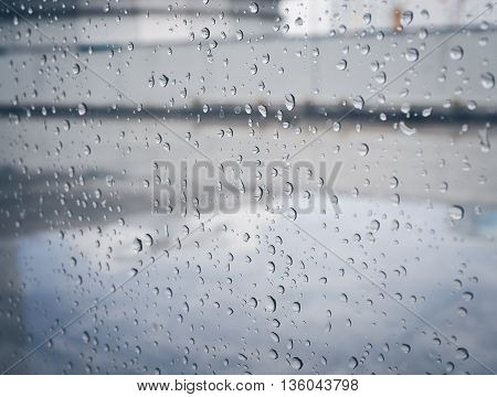 Selective focus, Raindrops on glass with city (raindrops,blur, rain)