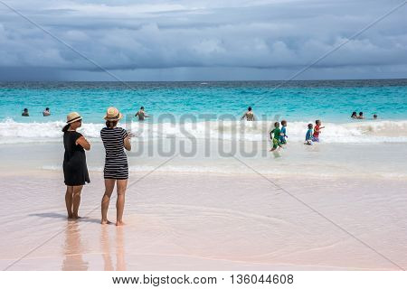 HORSESHOE BAY BERMUDA - MAY 26 - People enjoy the turquoise colored water of Horseshoe Bay Beach on May 26 2016 in Southampton Parish Bermuda.