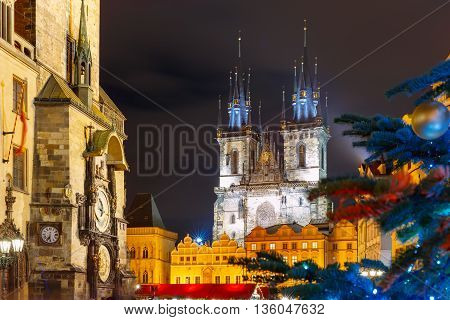 Old Town Hall with astronomical clock, Town Square with Christmas tree and fairy tale Church of our Lady Tyn in the magical city of Prague at night, Czech Republic