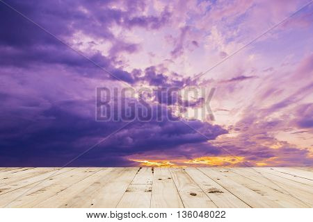 Wood Table And Dramatic Clouds Sunset In Thailand.