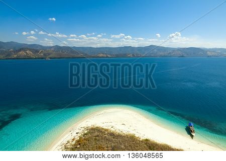 beautiful bay in island with boat in sunny summer day, Flores, Indonesia