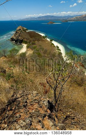 Beautiful tropical beach with sea view, clean water and blue sky, Flores, Indonesia