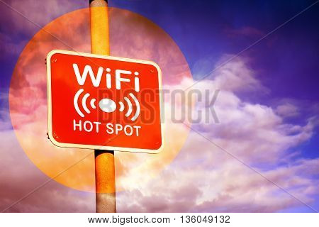 Red Wifi hotspot sign against a purple sky background