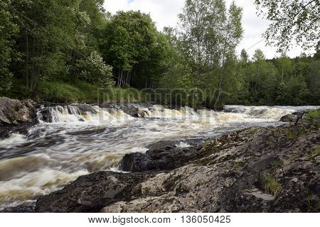 White water in a little river in spring time picture from the North of Sweden.