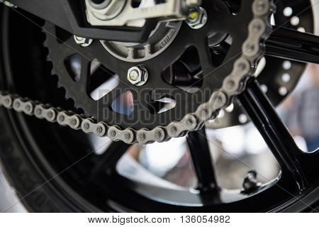 Modern motorcycle drive chain closeup. Shallow dof