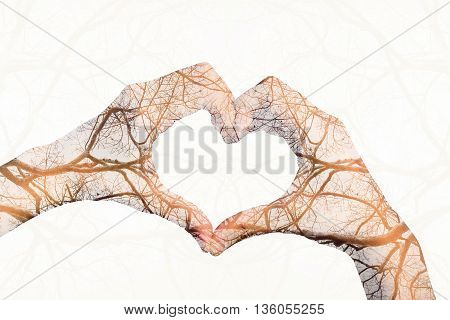 Girl hands in shape of love heart isolated on white background.