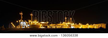 Gas turbine electrical power plant at night with light
