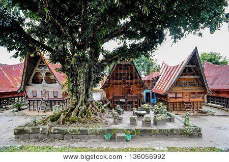SUMATRA, INDONESIA - 22 MAY 2015 : Three tradition batak houses in Bolon Simanindo Batak Museum Village