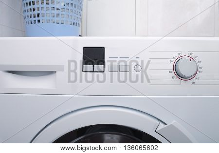 Washing machine with blank space on the panel.