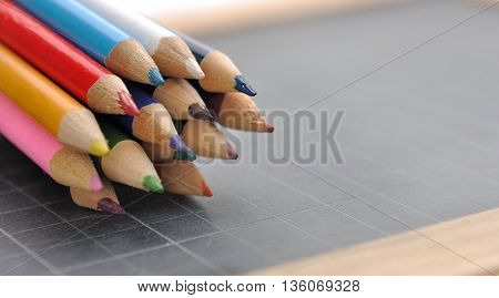 package of colored pencils on a slate