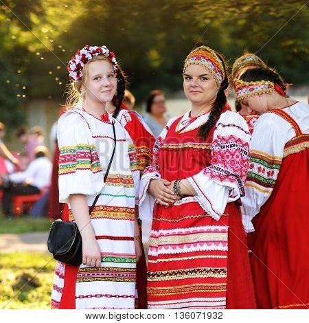 Orel Russia - June 24 2016: Turgenev Fest. Girls and women in traditional Russian sarafans and kokoshniks closeup