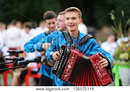Orel Russia - June 24 2016: Turgenev Fest. Boys in Russian shirts playing accordions horizontal