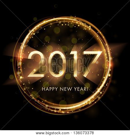 Gold New Year 2017 card. Happy New Year background with glowing sparkle circle. Star dust sparks in explosion on black background. Vector Illustration