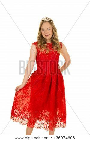 A woman with down syndrome in her lace red dress with a smile on her face.