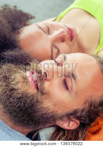 Closeup of beautiful backpacker tourist napping on a bench poster