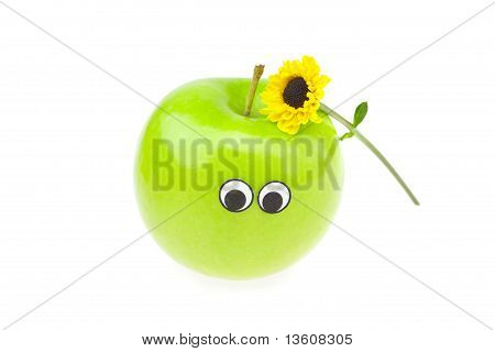 Joke Apple With Eyes And A Flower Isolated On White