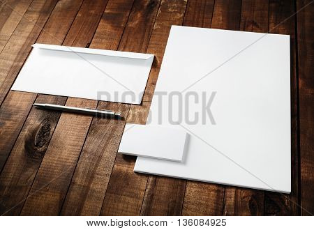 Photo of blank stationery set on light wooden background. Responsive design template. Blank mock-up for your design.