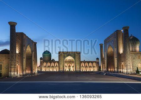 Registan Square in Samarkand, Uzbekistan, at the twilight.