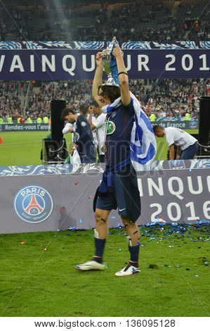 The picture show the football player Edinson Cavani, who plays in Paris Saint Germain team. It was in Paris, at Stade de France, on the 21th of May, 2016 after the game against Marselle when Paris Saint Germain was the winner of Coupe de France season 201