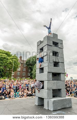 London United Kingdom - June 25 2016: Greenwich and Docklands International Festival. BLOCK dance performance by NoFit State Circus and Motionhouse Dance. The show explores life in the city; its contradictions and challenges. Twenty oversized blocks are d