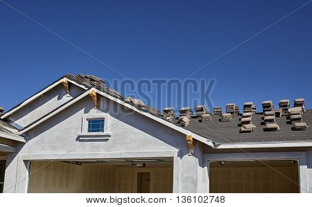 New Home Construction With New Gable Roof And Stucco