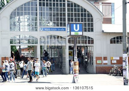 BERLIN, GERMANY - MAY 09: The busy entrance to the Metro Station Warsaw Street in Berlin Friedrichshain with pedestrians and passersby on May 09, 2015 in Berlin.