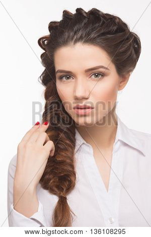Portrait of beautiful lady with long brown hair isolted on white background. Pretty lady with hair braid hairstyle posing in studio.