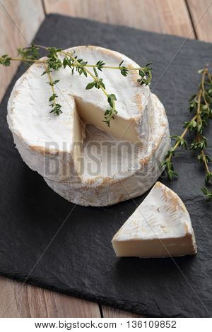 Camembert on a rustic table