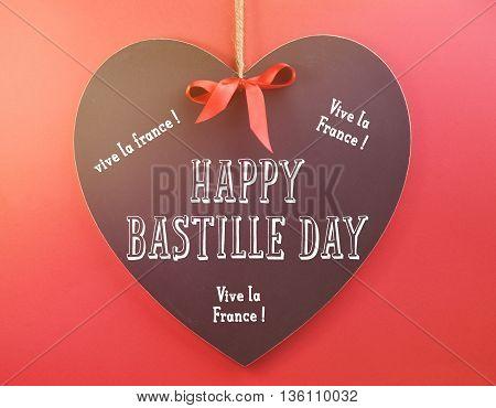 Happy Bastille Day Greeting On Heart Shape Blackboard