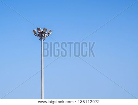 Light pole tower on clear blue sky with copy space.