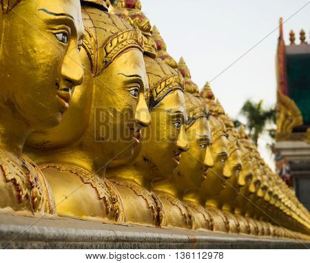 Brahma faces on top of temple wall in thailand