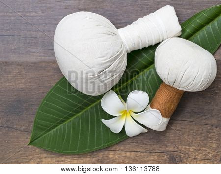 Spa massage compress balls, herbal ball on the leaves with spa flower, Thailand, select focus