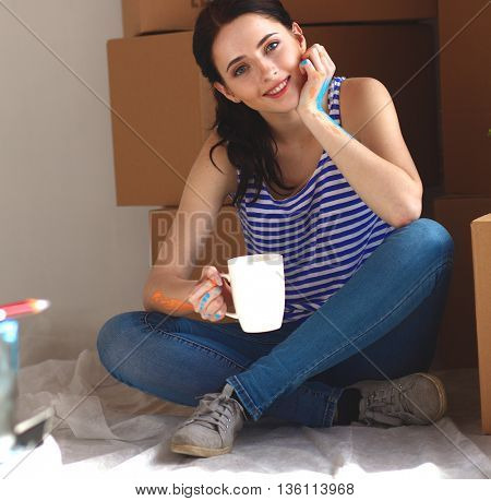 Young woman portrait while painting new apartment