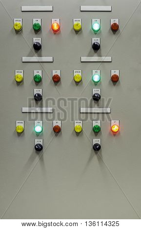 Group of status indicator light and selective switch of Auto-Manual on electrical control panel with blank name tag.