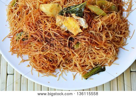 stir-fried thin rice noodle with black sweet soy sauce on dish