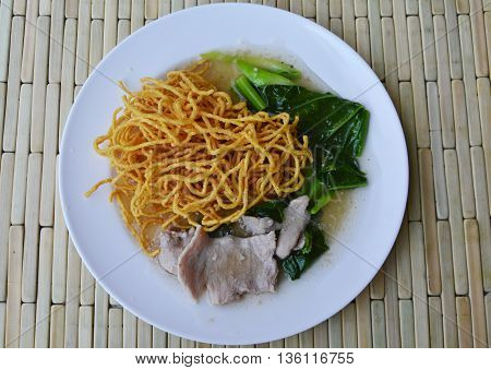 crispy yellow noodle dressing gravy sauce on plate