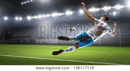 Soccer player hitting ball . Mixed media