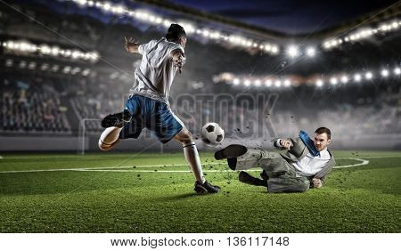 Businessman and player fighting for ball . Mixed media