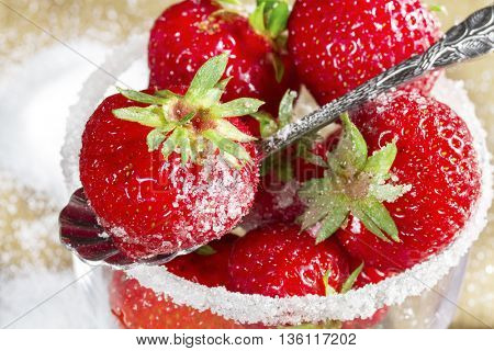 Ripe strawberry in sugar closeup