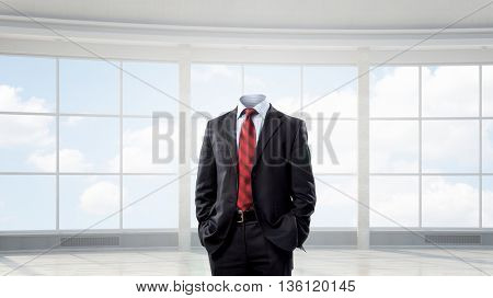 Businessman without head . Mixed media