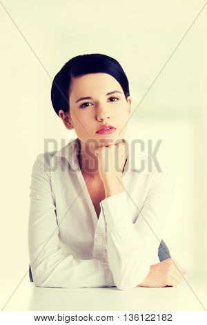 Pretty young woman in sitting at the desk