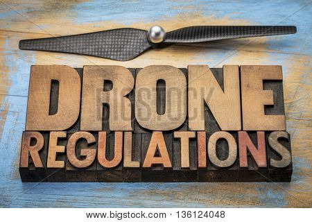 drone regulations word abstract in vintage letterpress  wood type