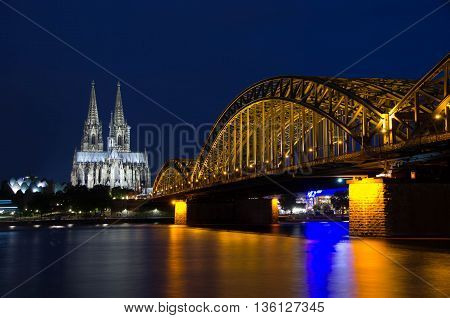 Cologne, North Rhine-Westphalia, Germany - June 11, 2016: View of Cologne Cathedral and Hohenzollern Bridge.